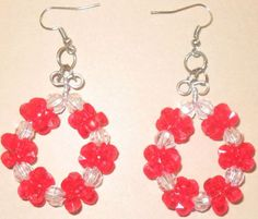 Red and clear star shaped round earrings.