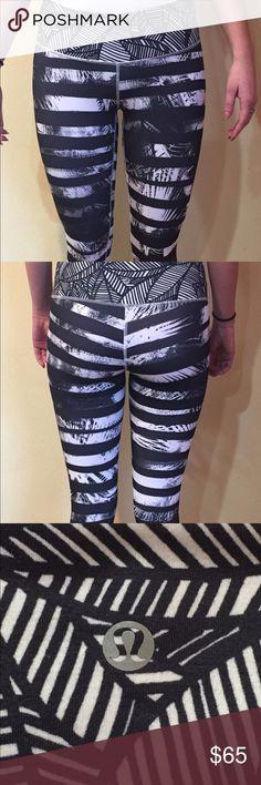 Lulemon Capri running tights, size 6 Black and white print. Size 6. Capri length. One small pocket inside front waistband. lululemon athletica Pants Leggings