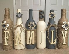 Custom decorated wine bottles by DeeDeeBean #decoratedwinebottles #recycledwinebottles #DIYHomeDecorWineBottles