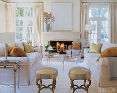 The living room of 2010 A-List designer Suzanne Kasler's Atlanta house, which she shares with her husband, John Morris, and their daughter, Alexandra; Bernard sofas upholstered in Concord Bone linen velvet flank a pair of Sanford acrylic tables, all by Nancy Corzine. The curtains are of the Silk Trading Co.'s Como silk, the mid-century bronze andirons are from Parc Monceau Antiques, and the Russian stools are from a Paris flea market.