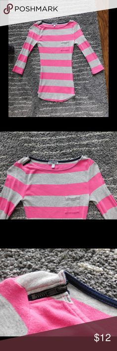 Pink & grey Express top Pre-loved Express top. Pink and light grey strips with small pocket on left side. Top right side has zipper detail--does not zip. Scoop neck, tight fitting with flattering shape. 53% modal 47% cotton. Express Tops Tees - Short Sleeve