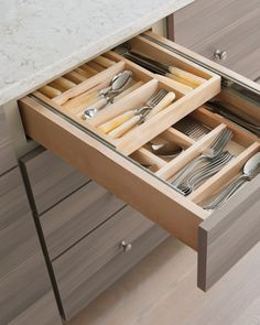 Because Martha wanted to make the most of a small space, she packed the Maple Avenue kitchen with smart storage solutions, like these cutlery drawer dividers. They make storing flatware an organized breeze, and the stacked dividers provide ample storage. Shop Martha Stewart Living Kitchens at The Home Depot