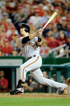 Buster Posey #28 of the San Francisco Giants hits a home run in the sixth inning against the Washington Nationals at Nationals Park on August 22, 2014 in Washington, DC. (August 21, 2014 - Source: Greg Fiume/Getty Images North America)
