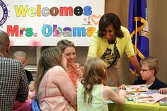 Mrs. O wearing a Peter Som print top, yellow cardigan, and trousers.  In this photo she's visiting families at the Walter Reed National Military Medical Center in Bethesda, MD.  SHE'S AWESOME!!