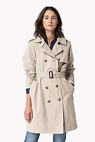 Trendy sophistication. Double-breasted trench crafted from a peached cotton blend. Design details include a broad collar and lapel, epaulettes, fixed storm flaps, waist belt and buckled cuff tabs. At the back the fixed yoke and centred vent complete the look. Welt pockets at the hips. Tommy Hilfiger branding on the buttons.<br/><br/>Our model is 1.76m and is wearing a size S Tommy Hilfiger trench coat.