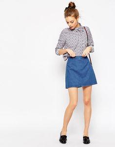 Immagine 1 di ASOS - Minigonna di jeans svasata lavaggio blu medio