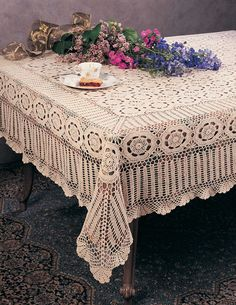 Hand crochet table cloth - I have one similar to this.