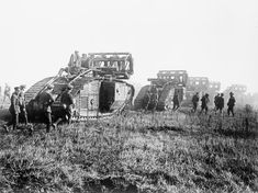 MINISTRY INFORMATION FIRST WORLD WAR OFFICIAL COLLECTION (Q 9364)   Battle of St. Quentin Canal. Mark V Tanks going forward with the 'Cribs' carried to enable them to cross the Hindenburg Line. Bellicourt, 29 September 1918.