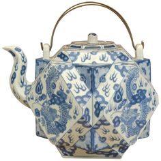 China 18th Century Rare 18th Century Cantonese Tea Pot, with blue and white decoration in the Chinese taste, depicting dragons and foliate designs, and having an unusual wire handle.