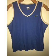 Nike Dri-Fit Workout Top good condition! some fading and wear on the label but nothing excessive. make an offer! Nike Tops Tank Tops