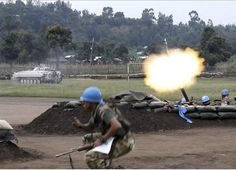 The United Nations mission in Democratic Republic of Congo, on August 2012 shows members of MONUSCO's Indian battalion firing a mortar during fighting in Kiwanja between rebel and the Congolese army on July (AFP PHOTO / MONUSCO) Red Team, Indian Army, 25 Years Old, United Nations, Republic Of The Congo, Rebel, Crime, Military, July 28