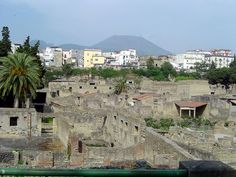 Ruins of Herculaneum, Ercolano, and Mt Vesuvius.  After the eruption of Mount Vesuvius in 79 AD, the town of Herculaneum was buried under approximately 20 meters (50–60 feet) of ash. It lay hidden and largely intact until discoveries from wells and underground tunnels became gradually more widely known, and notably following the Prince d'Elbeuf's explorations in the early 1700s.