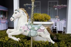 Mary Poppins Tea Party for her daughter Olivia's 7th birthday... love the carosel horse.