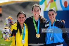 July 11 - Cycling BMX - Women's - Final. Silver medallist Domenica Azuero of Ecuador, gold medallist Felicia Stancil of USA and bronze medallist Mariana Diaz of Argentina pose at the podium after winning women's BMX Final during the Toronto 2015 Pan Am Games at Centennial Park on July 11, 2015 in Toronto, Canada.