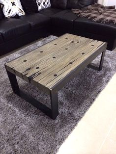 Heritage Australian Hardwood farm fence posts coffee table with aged grey finish and black resin with mild steel flat bar frame