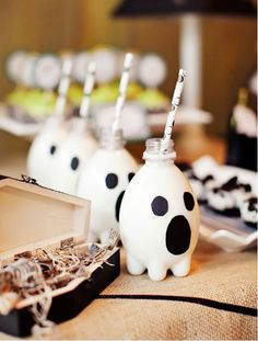 cleverly painted water bottles to resemble ghosts topped off with a black polka-dot straw! Cute for a #Halloween #Party