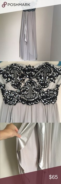 Lace and Sequin Formal Gown Price Drop Grey and black formal gown. Side slit with sheer overlay. Sequin and lace detail on the back. Zip closure. Comes with scarf. Offers are always welcomed with the offer button! Dresses Prom