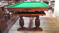 Riley oak antique snooker diner table after restoration. Heavily carved legs on this refectory style diner.