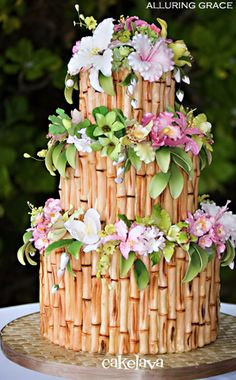 Bamboo and tropical flowers wedding cake
