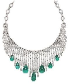 An elegant Art Deco emerald and diamond necklace, 1920s. Designed as a graduated cascade of articulated icicle drops set throughout with circular-cut diamonds, suspending a series of polished emerald drops, continuing to the back with diamond set navette-shaped links, mounted in platinum. #ArtDeco #necklace