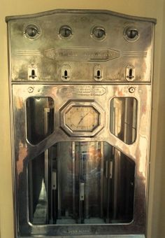 Antique cigarette vending machine with a clock
