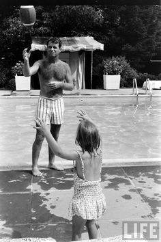 "electronicsquid: ""Robert Kennedy plays catch by the pool (George Silk. 1964) """