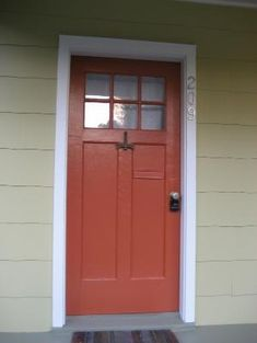 this is jalepeno!! your wall color! it looks great! how about this color for your door too!!!! Sherwin Williams Jalapeno paint | orange red front door by katheryn
