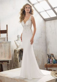 2017 Wedding Dresses and Bridal Gowns by Morilee. Stunning Sheath Bridal Dress with Crystals on the Bodice and the Open Back and Illusion Cutouts at the Waist.