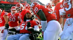 Classy move by the Tampa Bay Bucs to sign paralyzed Rutgers player Eric LeGrand to symbolic contract.