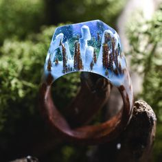 Stare into these ring-shaped microcosms meticulously crafted from wood, resin, and beeswax by Vancouver-based jeweler Secret Wood and you're peering into the physical manifestation of Waldeinsamkeit, the German word describing the ineffable feeling of communing with nature.