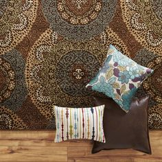 Over-scaled Susani medallions in blue and brown, creates a worthy base for your room decor.