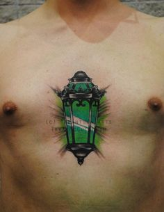 Despite the imeediate Green Lantern reference, it is actually for The Great Gatsby - the light across the lake. Done at the Hampton Roads Tattoo Festival, and it was his first tattoo! Difficult spo...