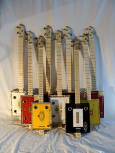 Look at these beauties.  We sell lots of parts to cigar box guitar builders.  www.guitarhuggers.com