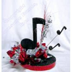"*Choose the foil colors for this centerpiece on a 12"" Glamour Base with your choice of ribbon edge trim.  The design includes one large and two small Black Cracked Ice Music Notes, a spray and a music note theme spray.  Assembly required.  Approx. dim: 12""w x 16"" tall   - $22 each"