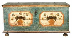 """The painted decoration on this Pennsylvania-German chest relates to the work of the fraktur artists Henrich and Daniel Otto and was probably executed by one of these men. When pictured in Fabian's seminal work on the subject the chest lacked feet, but Monroe Fabian noted that it most likely had turned feet as indicated on the underside. Consequently appropriate feet have been expertly restored to this exceptional and rare chest.         H 23 ½"""", W 48"""", D 20 ¾""""   Circa: 1800"""