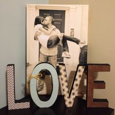 My canvas engagement pic and homemade decorative letters to match the accented wall and bedroom