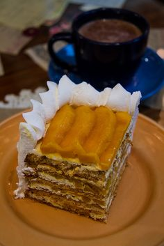 I'm not a big fan of desserts, but a Mango Bene mmmMMMM... layers of meringue with homemade cream and sweet mango slices in between. This one's from Mary Grace (great cafe chain in Manila), served with traditional tsokolate. Photo by Keith Kelly, via Flickr.