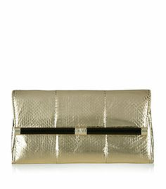 Diane Von Furstenberg Envelope Snake Clutch Complete your evening wear with a statement clutch bound to capture admiring glances. DVF's gold snake print clutch features a leather covered bar on the front flap and interior zip pocket. This slimline bag fits a few essentials to ensure an effortlessly glamorous look. https://www.facebook.com/pages/Fashion-Trends-and-Discounts/137797606390386