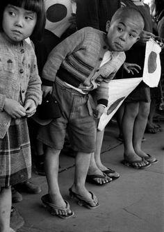 Werner Bischof 1951 JAPAN. Hiroshima. Children waiting for the arrival of Emperor...