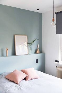 Love this dusky blue wall for the bedroom with the pink cushions on the bed.
