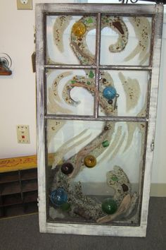 A little bit of summer days captured forever on this antique window frame... watch the colors come to life as the sun shines through the
