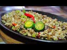 CHICKEN SISIG is a Filipino dish originated from the province of Pampanga. It consists of chicken thigh or breast and chicken liver, mixed all together on a . Chicken Recipe Filipino Style, Chicken Adobo Recipe Easy, Shredded Chicken Recipes, Chicken Breast Recipes Healthy, Easy Chicken Recipes, Chicken Sisig, Garlic Fried Chicken, Pork Sisig, Filipino Dishes