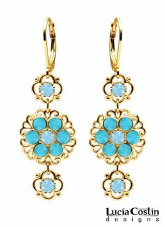 Trendy Dangle Earrings by Lucia Costin Adorned with Filigree Elements, 4 Petal Flowers, Dots, Light Blue and Turquoise Swarovski Crystals; 14K Yellow Gold over .925 Sterling Silver; Handmade in USA Lucia Costin. $63.00. Flowery dangle earrings amazingly designed by Lucia Costin. Update your everyday style with inspiration when wearing this piece of jewelry. Unique jewelry handmade in USA. Garnished with turquoise and aquamarine Swarovski crystals. Splendid com...