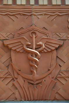Art Deco Caduceus - Rod of Hermes, smiling double snakes, anchor, shield, wings, circle, architectural decor, PAC-MED related buildings, Beacon Hill, Seattle, Washington, USA | by Wonderlane