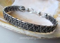 This all Sterling Silver bracelet is woven in a beautiful pattern and a patina finish brings out the textures of the weaving.  It is 6/8 inches wide and fits best on wrist sizes 7 1/2 to 8 inches.  It