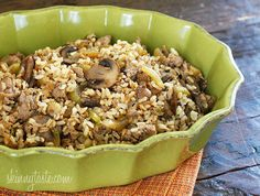 Brown rice stuffing made with Italian chicken sausage, celery, mushrooms, and onions. Serve this as a Thanksgiving side dish or you can even enjoy this as a meal. It's so good and naturally gluten free!    I've had my eye on this dish from my friend Julia's blog for quite a while. She calls it Riso Condito and when I finally got around to making it I was doing the happy dance in my kitchen and had to let her know how good it was! I made minor tweaks to her original recipe but for the most…