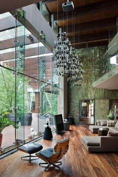 Modern House Near Moscow by architect Olga Freiman    With spectral giant windows like this all the seating is placed to face the greenery beyond.