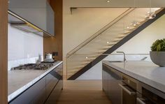 note ~ no overhang on the stone counter with the contemporary flat cabinetry