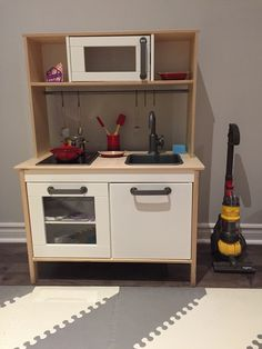 Kids Ikea kitchen, Pottery Barn Kids Creuset accessories and toy dyson vacuum