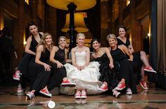 Julia gave all her bridesmaids new shoes - red Converse Chucks so they could dance through the reception. ginacristinephotography.com/2014/03/julia-kyle-w-chicago/